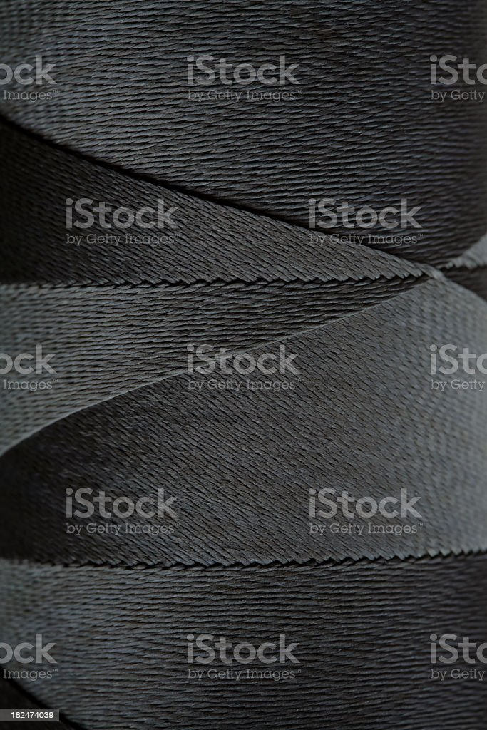 Black spool of thread royalty-free stock photo