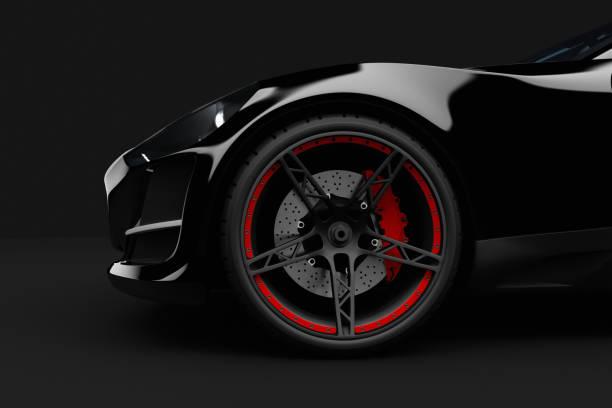 schwarz sport auto auf dunklem hintergrund - alufelgen stock-fotos und bilder