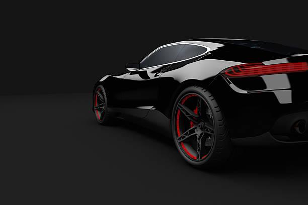 Black sport car on dark background