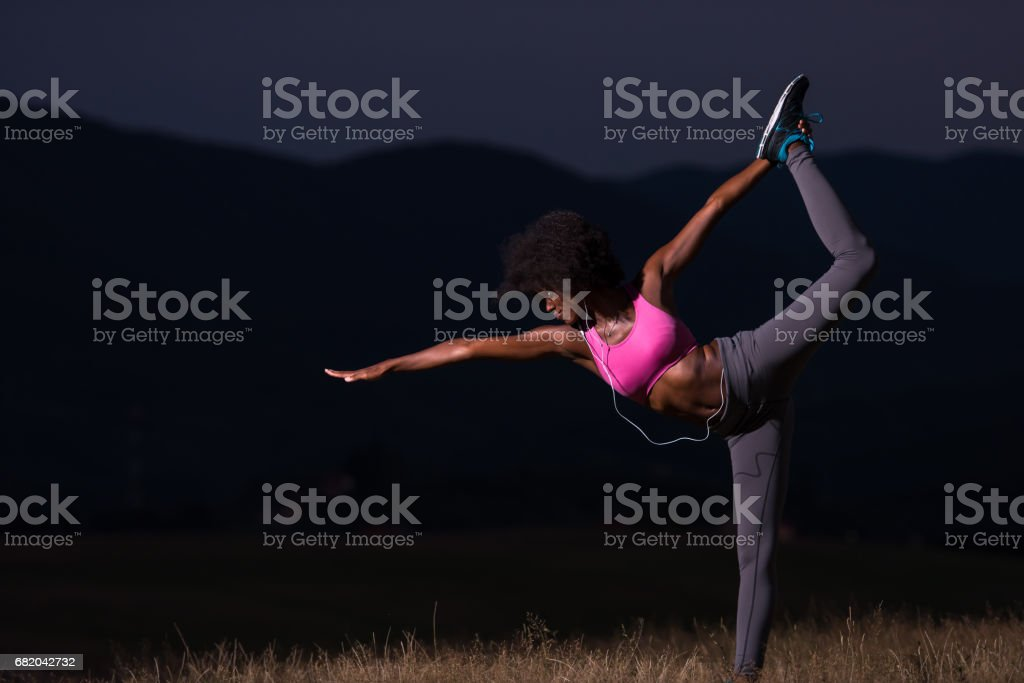 black sporty woman exercising yoga yoga  in the nature stock photo