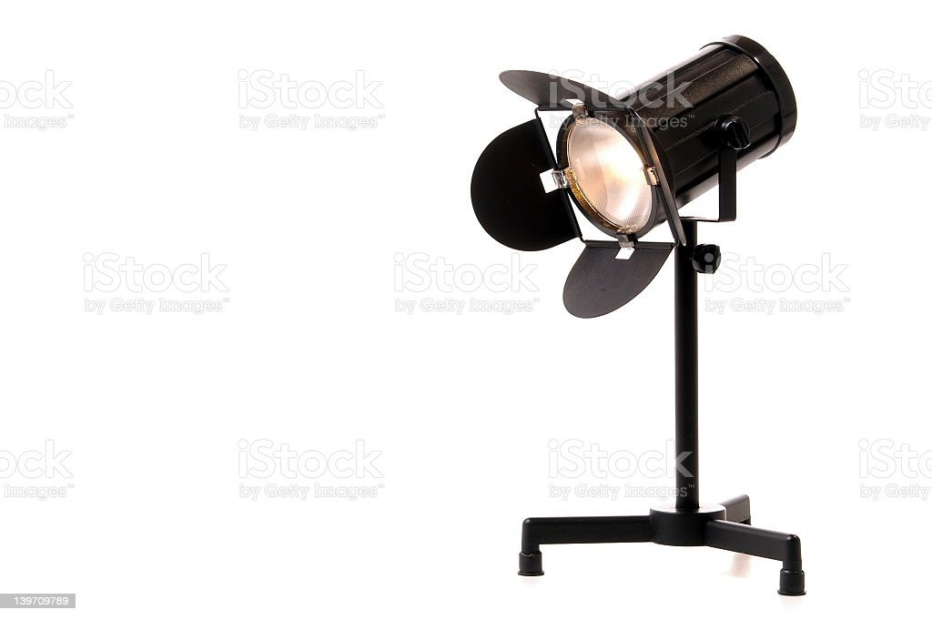 A black spotlight isolated on a white background royalty-free stock photo