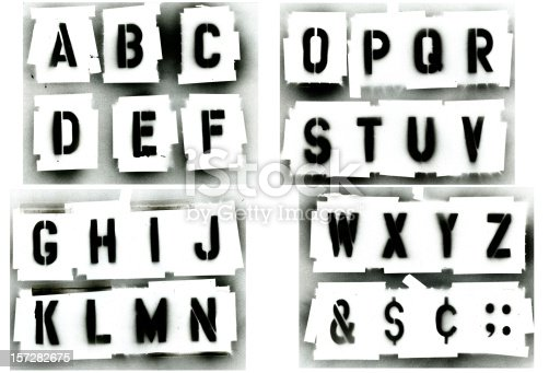 Full alphabet stencil set.  Sprayed with black spray paint on white background.  Great for grunge designs, paint is runny spotted.