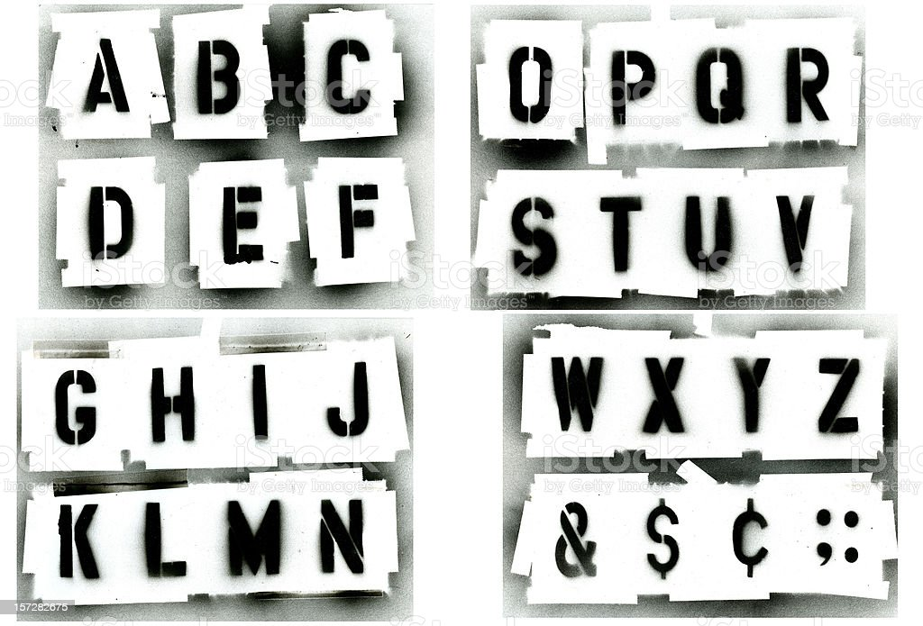 Black spray painted stencil alphabet set stock photo
