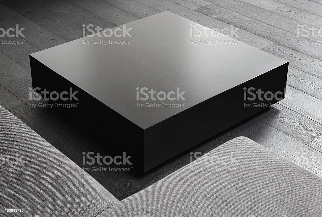 Black square coffee-table, modern interior detail stock photo