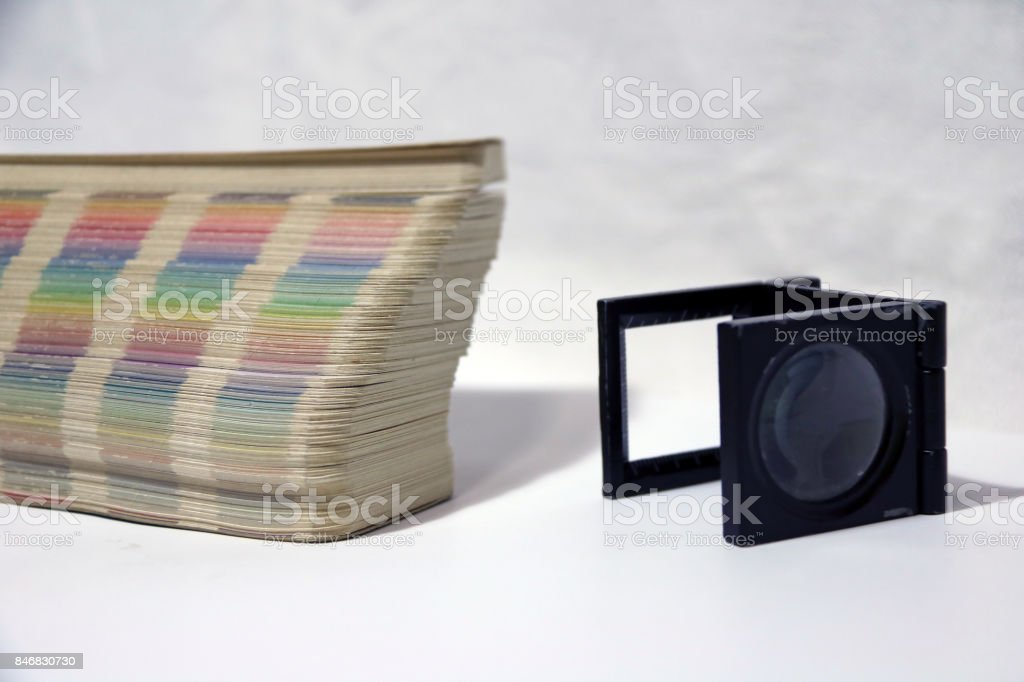 Black square Magnifying glass and Rainbow Sample Colors Palette Catalog. stock photo
