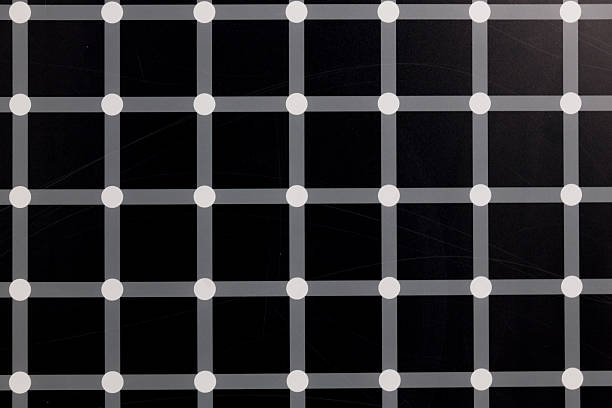black squares and flashing dots - illusion stock photos and pictures