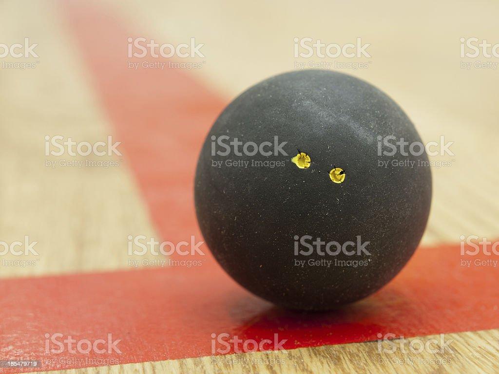 Black squash ball on t-line. royalty-free stock photo