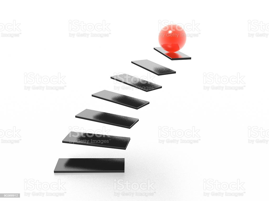 Black stairs leading up to a red ball stock photo