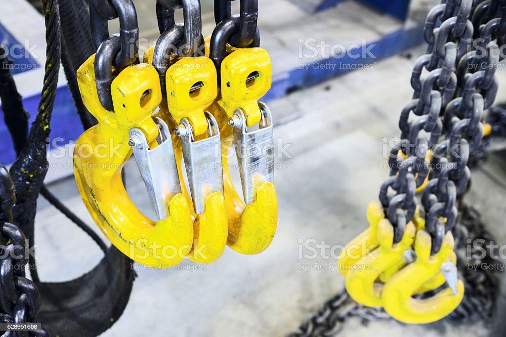 Black steel chain and yellow cargo hooks. stock photo