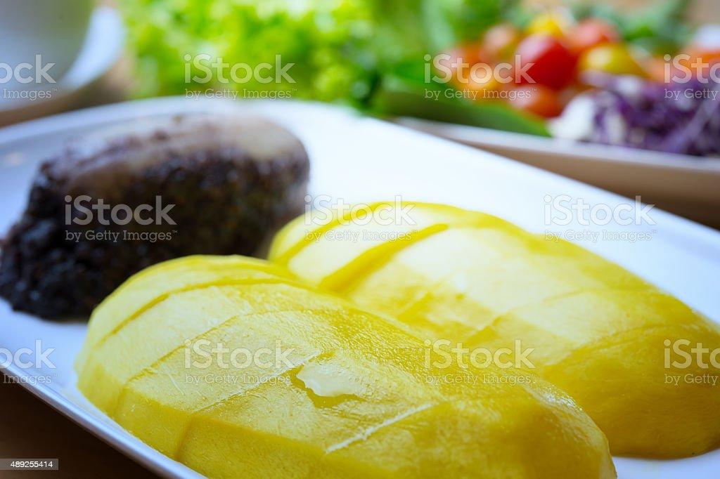 Black Sticky Rice and banana With Mango stock photo
