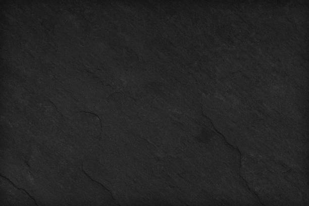 Fond de pierre noire. Sombre texture grise fermer vers le haut de haute qualité peut être utilisé vide pour la conception. Espace copie - Photo