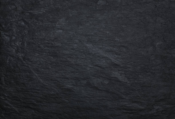 Black stone background Black stone background, texture with copy space marble rock stock pictures, royalty-free photos & images