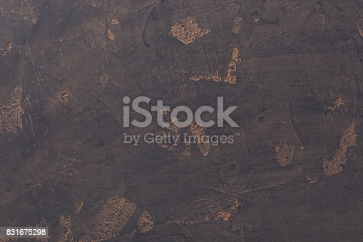 istock Black stone background with cocoa powder remains 831675298