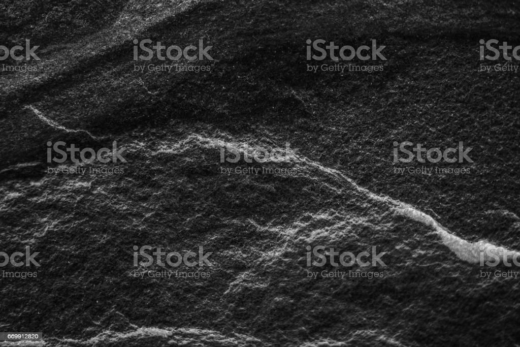 Black stone pattern texture background, Detailed of real genuine stone from nature stock photo