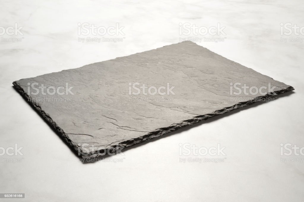 black stone plate on marble table stock photo more pictures of