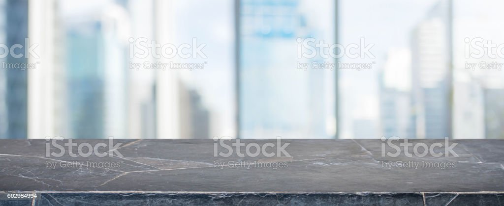 Black Stone table top and blur glass window wall building banner background stock photo