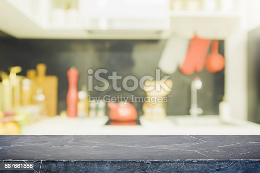 istock Black stone table top and blurred kitchen interior background - can used for display or montage your products. 867661888