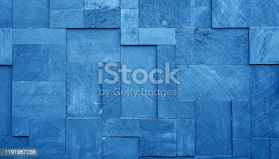 istock Black stone wall texture background.  Classic blue color of the year 2020. 1191987255