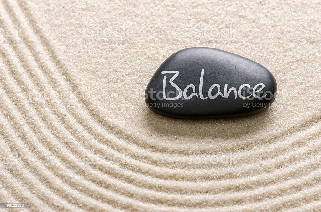 Black stone with the inscription Balance stock photo