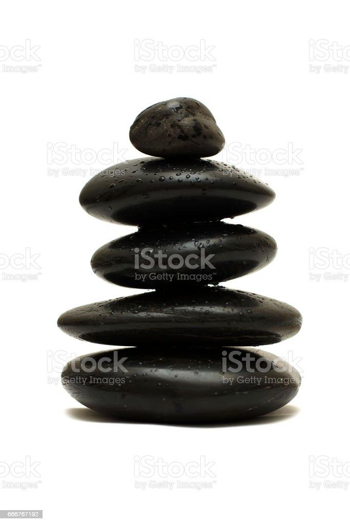 Black stones isolated on white background stock photo