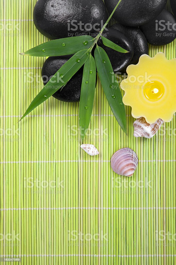 Black stones with bamboo leaf in a zen spa royalty-free stock photo