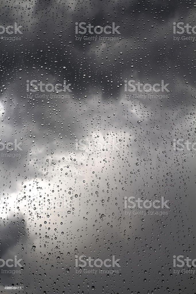 Black stormy sky and rain drops stock photo