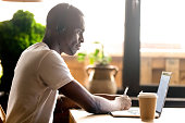istock Black student studying using laptop and headphones 1128717591