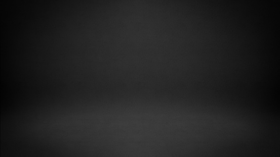 istock Black Studio Background 1050245638