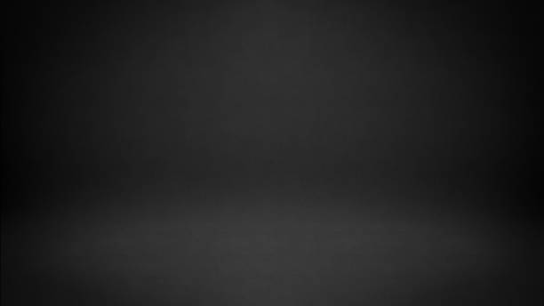 black studio background - black background stock pictures, royalty-free photos & images