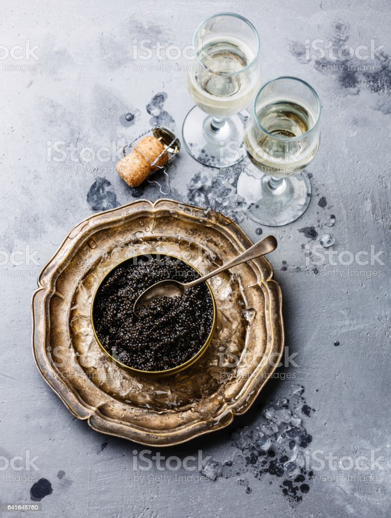 Black Sturgeon caviar in can and champagne stock photo