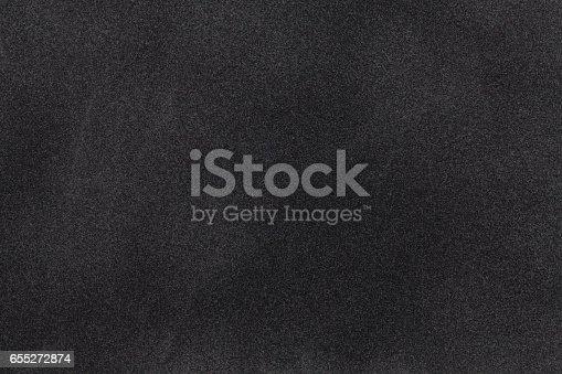 istock Black suede fabric closeup. Velvet texture. 655272874