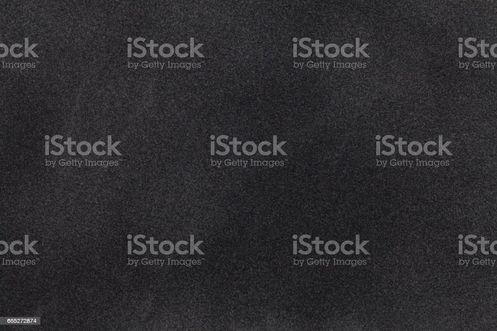 Black suede fabric closeup. Velvet texture. stock photo