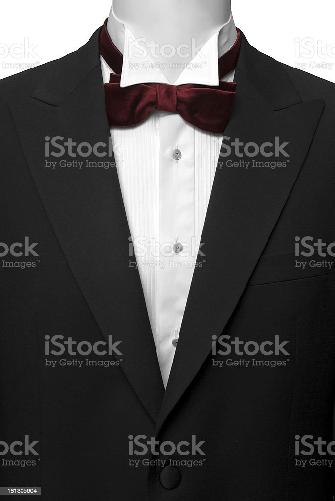 black suite (tuxedo) with white shirt and bow tie stock photo