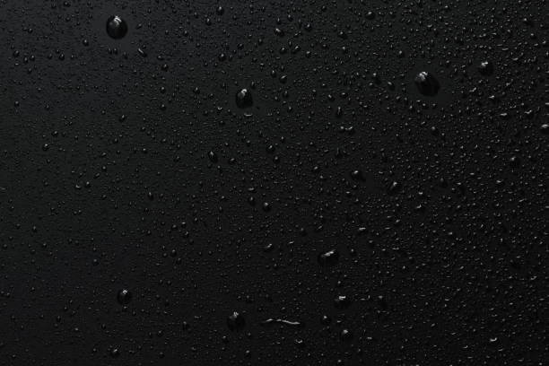 black surface with clear water drops, background - glass material stock pictures, royalty-free photos & images