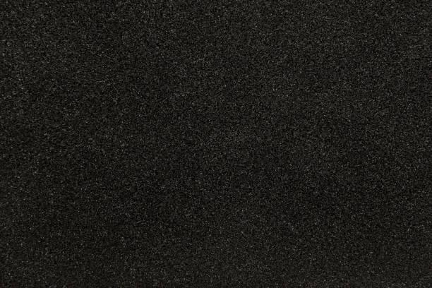 black synthetic sponge texture for background - spugna per le pulizie foto e immagini stock