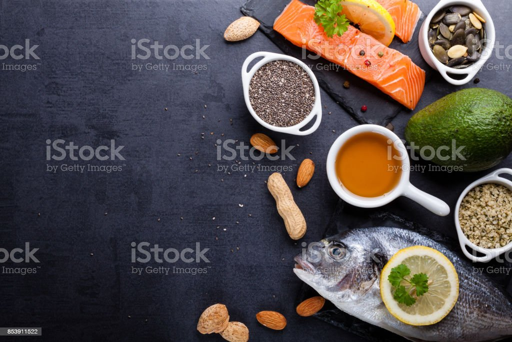 Black table with ingredients of food rich in vitamin D and omega 3, with copy space. stock photo