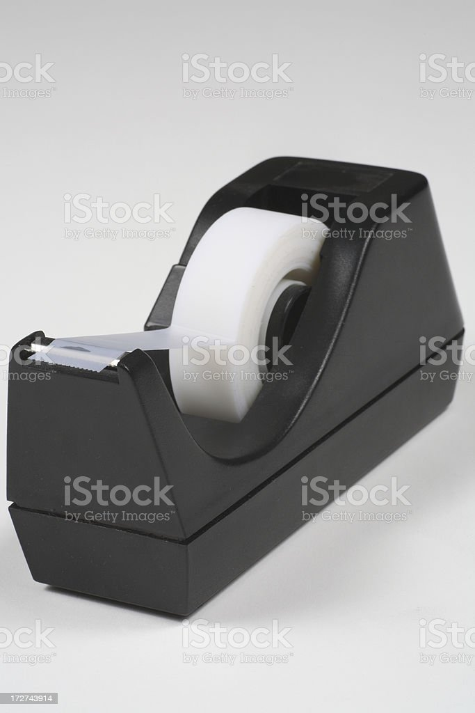Black tape dispenser on white background with room for text stock photo