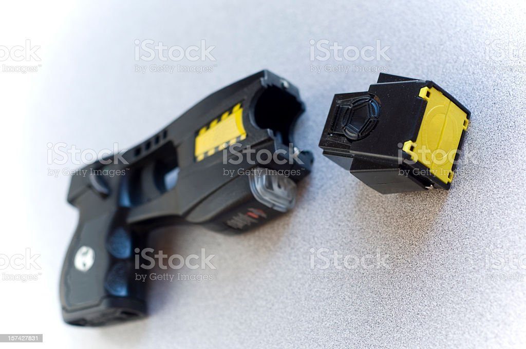Black Taser with part unattached stock photo