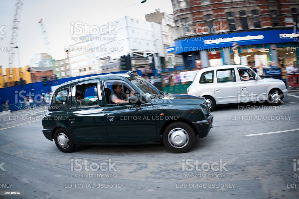 Black taxi cab in central London, motion blur royalty-free stock photo