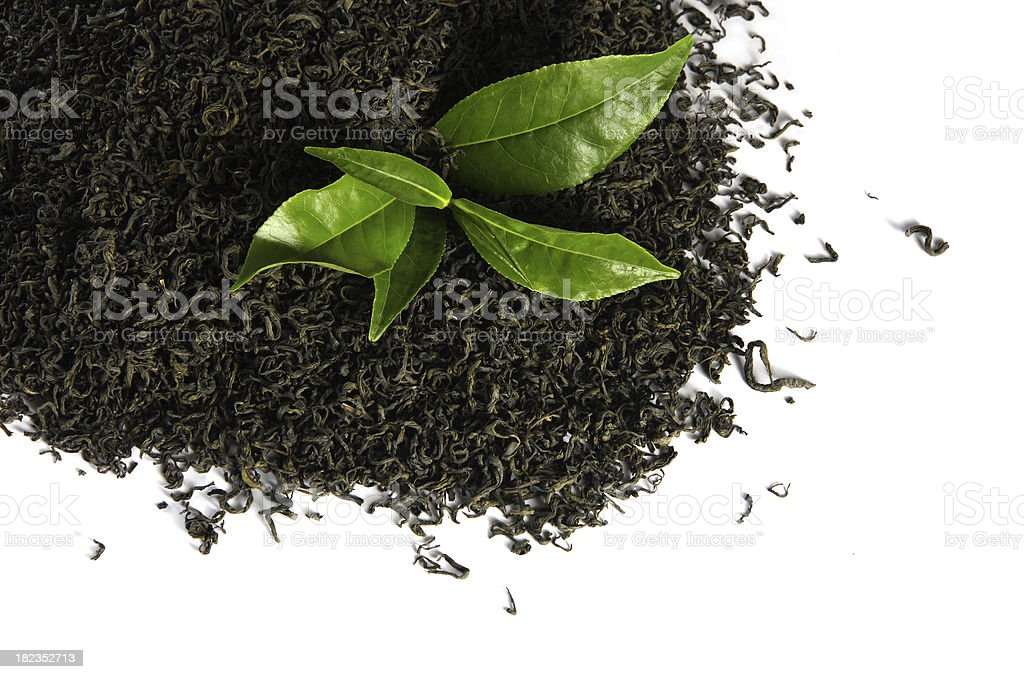 Black Tea and green  leaves royalty-free stock photo