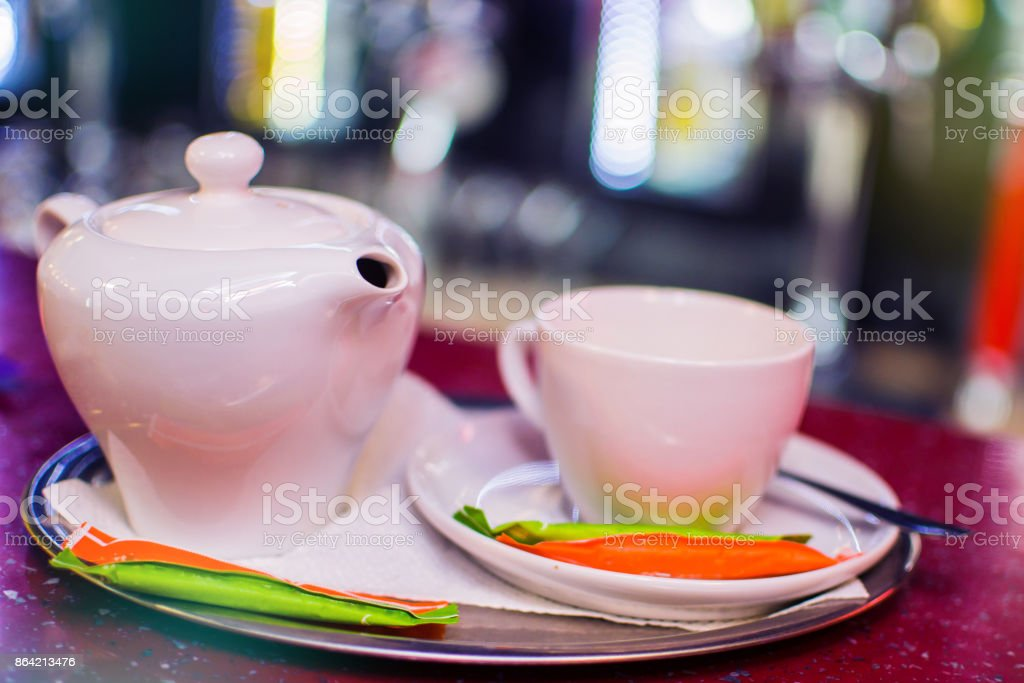 Black tea in a ceramic teapot on a tray with a cup royalty-free stock photo
