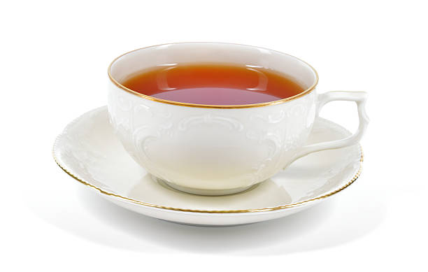 Black tea in a porcelain cup. stock photo