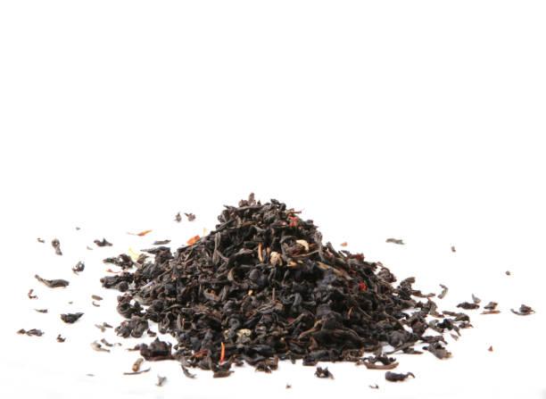 black tea leaves - grüner tee koffein stock-fotos und bilder