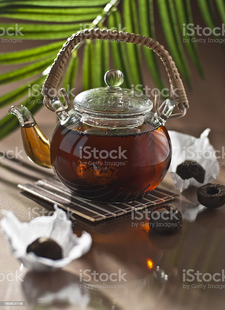 Black Tea Puer in Glass teapot royalty-free stock photo