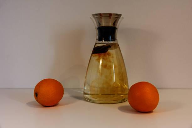 schwarzer Tee mit Orangen – Foto