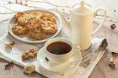 istock Black tee and tasty cookies at breakfast 1045565574