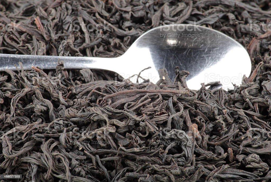 black tee and teaspoon stock photo