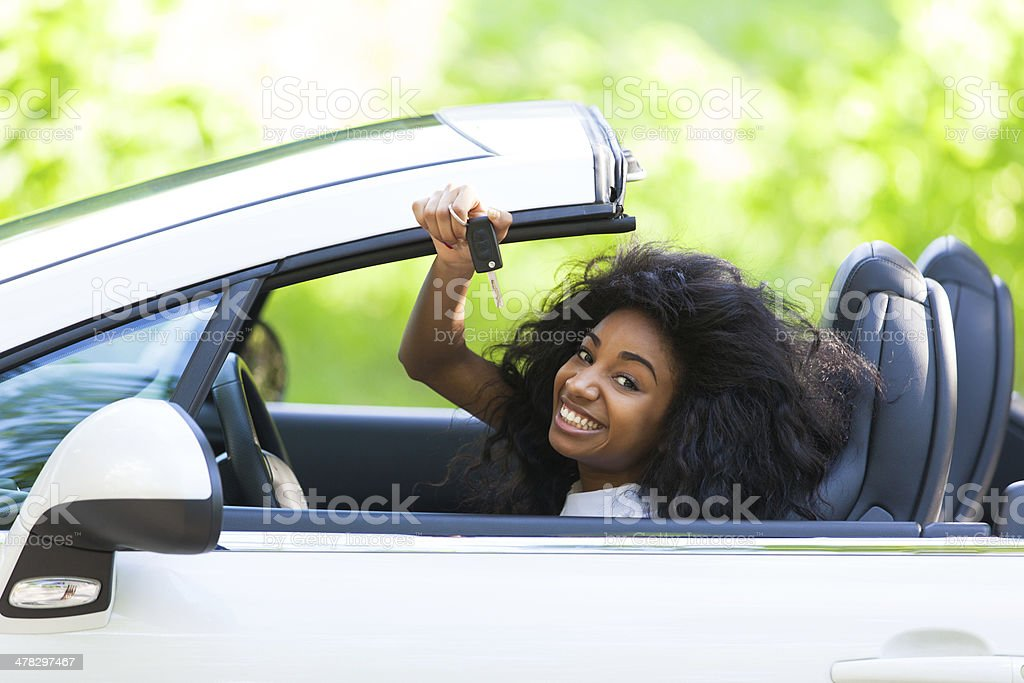 Black teenage driver holding car keys royalty-free stock photo