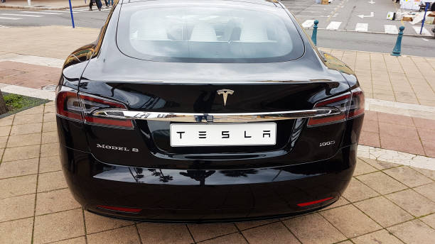 Black Tesla Model S Electric Car - Rear View Menton: Black Tesla Model S (Rear View) Electric Car Parked on a Square in Menton on The French Riviera. The Tesla Model S is a Luxury Full-Sized Electric Five Door tesla model s stock pictures, royalty-free photos & images