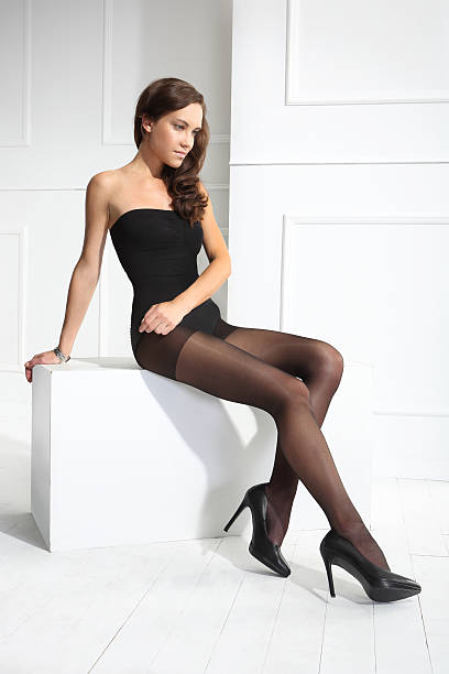 black tights - black women wearing pantyhose stock photos and pictures